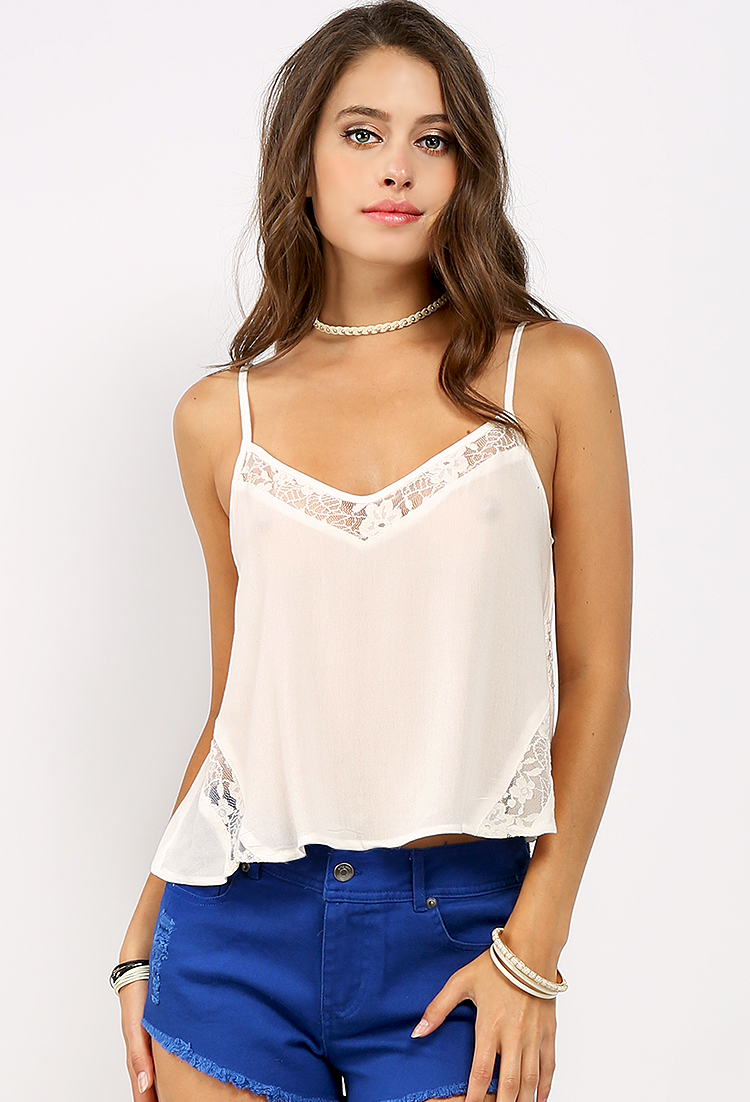 Camis + Tanks All the best women's camis and tank tops are right here at Urban Outfitters. Browse our halter tops, cropped tanks, strapless tops and bustier tops for a look you love.