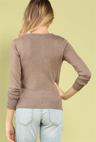 Whatever the season, reach for our touchably soft fleece cardigan sweater. An ideal layering piece for casual outfits, it goes perfectly over a cotton blouse or with your favorite jeans.