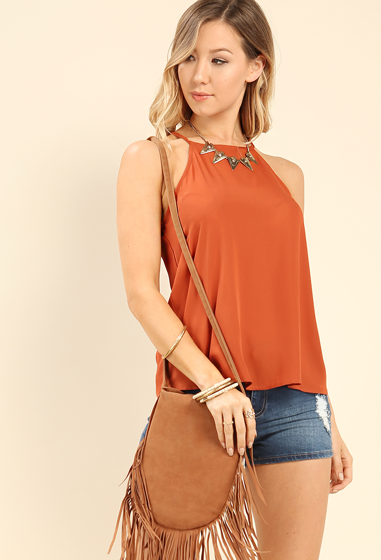 Warehouse Cami Top Cutting an elegant silhouette with its high neckline, this cami top by Warehouse is easily dressed up or down this season in its classic ivory hue. Team yours with skinny jeans and sandals for a lovely leggy silhouette.