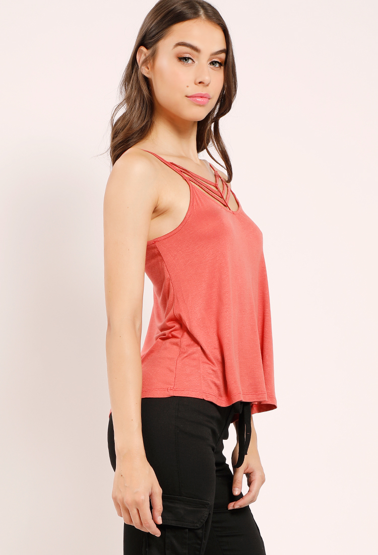 Top off your look with our on-trend edit of t-shirts, blouses, vests and strappy camis.