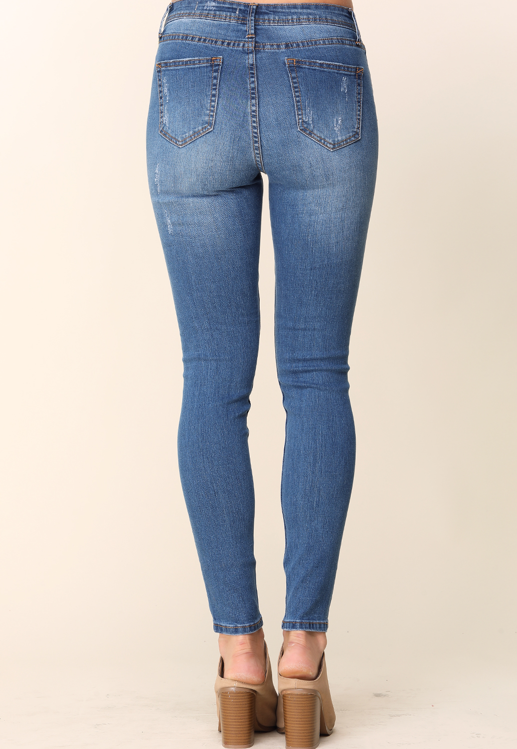 Distressed Mid-Rise Skinny Jeans